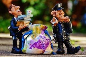 tax evasion police handcuffs